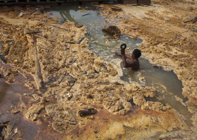 Artisan miners still work at a once illegal gold mine in the Peruvian Amazon. The government via series of raids attempted to shut down the area from illegal gold mining.