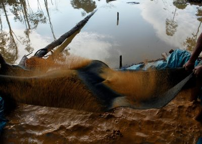 Illegal gold miners work in the miner city of Lamal. Miners use mercury in the process of mining for gold.