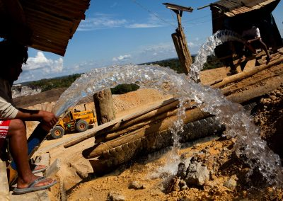 Process of gold mining at a legally approved mine.
