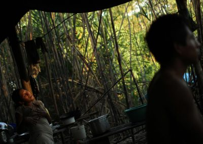 Illegal gold miners in their camp along the Madre Dios River. The area is currently being destroyed by the miners who are driven by poverty and the hope of a better life.