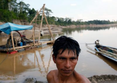Illegal gold miners that live on the Madre Dios River.